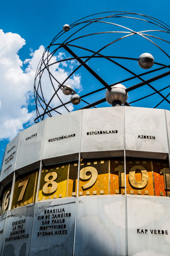 atomic clock, blue sky, and white clouds in Berlin, Germany